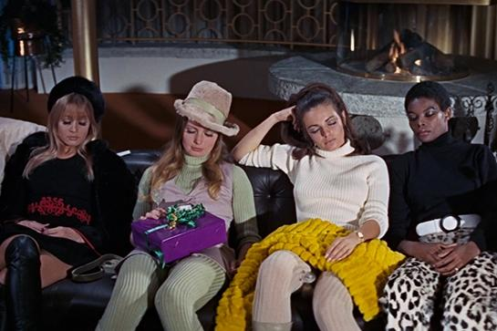 """<em><h2>On Her Majesty's Secret Service (1969)</h2></em><br><em>Yes</em>, this is the Bond movie everyone hates because it stars the drippiest 007 ever — a male model named George Lazenby who had the misfortune of being neither a real actor, nor Sean Connery. But, as an artifact of midcentury cheese, this film cannot be beat.<br><br>Bond's paramour is played by <em>The Avengers</em> star Diana Rigg, the official <a href=""""http://images2.fanpop.com/image/photos/9300000/Diana-Rigg-diana-rigg-9381019-2105-1820.jpg"""" rel=""""nofollow noopener"""" target=""""_blank"""" data-ylk=""""slk:queen of the jumpsuit"""" class=""""link rapid-noclick-resp"""">queen of the jumpsuit</a>. And the Bond villain, played by Telly Savalas, attempts a world takeover by brainwashing 12 beautiful women at a Swiss allergy clinic (no really) into """"angels of death."""" Have I mentioned that these women are played by a Pre-<em>Absolutely Fabulous </em><a href=""""http://ris.fashion.telegraph.co.uk/RichImageService.svc/imagecontent/1/TMG9625837/m/abfab-rex_2375799a.jpg"""" rel=""""nofollow noopener"""" target=""""_blank"""" data-ylk=""""slk:Joanna Lumley"""" class=""""link rapid-noclick-resp"""">Joanna Lumley</a> and an assortment of <em>Playboy</em> bunnies?<br><br>One hundred percent worth it for the groovy late-'60s fashion (Rib-knit jumpsuits! Cheetah pants!), and the laughably anti-climactic chase scene on skis.<span class=""""copyright"""">Photo: Courtesy of MGM.</span>"""