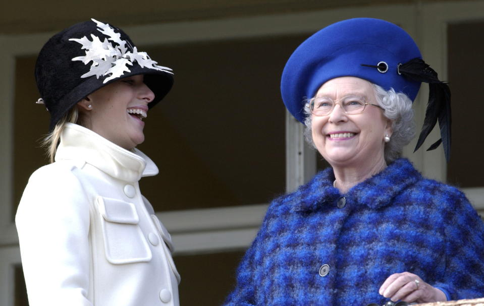 CHELTENHAM, UNITED KINGDOM - MARCH 13:  Queen Elizabeth Ll Laughing And Joking With Her Granddaughter, Zara Phillips, On Gold Cup Day At The Cheltenham National Hunt Festival. (queen Coat By Hardy Amies And Hat By Frederick Fox - D.mail 14.3.03)  (Photo by Tim Graham Photo Library via Getty Images)