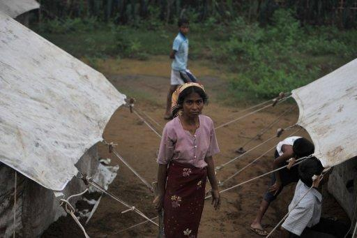 A Myanmar Muslim Rohingya stands in a temporary relief camp for people displaced by days of sectarian violence on the outskirts of Sittwe in June 2012. Speaking a Bengali dialect similar to one in southeast Bangladesh, the Rohingyas are Muslims seen as illegal immigrants by the Buddhist-majority Myanmar government and many Burmese