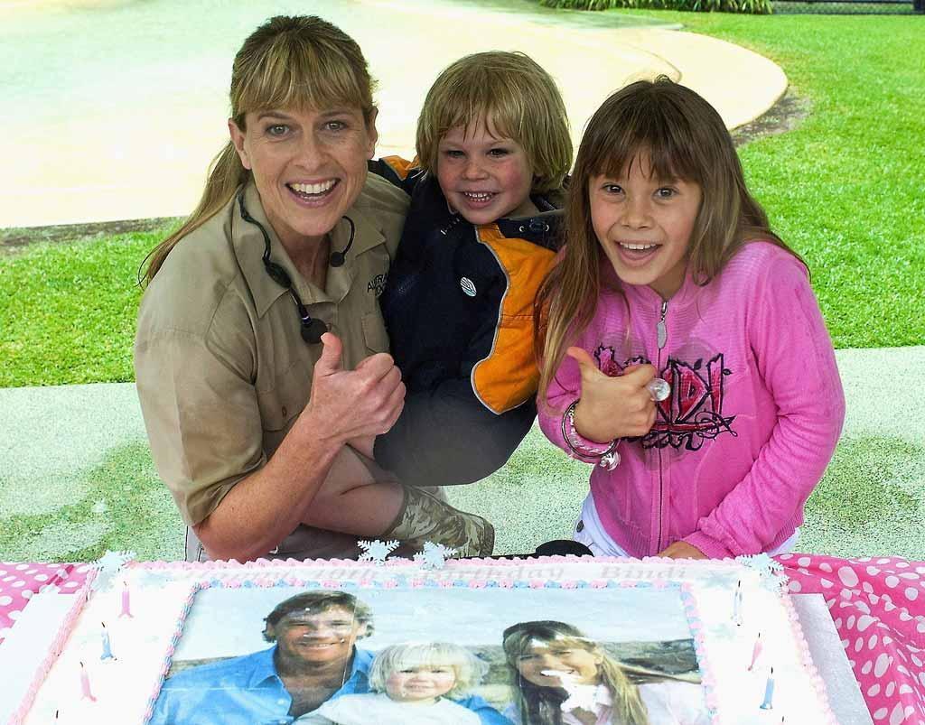 """Bindi Irwin celebrated her 10th birthday on Wednesday at the Australia Zoo with her mother Terri and brother Robert. Bindi's cake featured an image of her late father Steve (aka the Crocodile Hunter), whose legacy she hopes to continue with her own nature TV shows. Marc Grimwade/<a href=""""http://www.wireimage.com"""" target=""""new"""">WireImage.com</a> - July 24, 2008"""