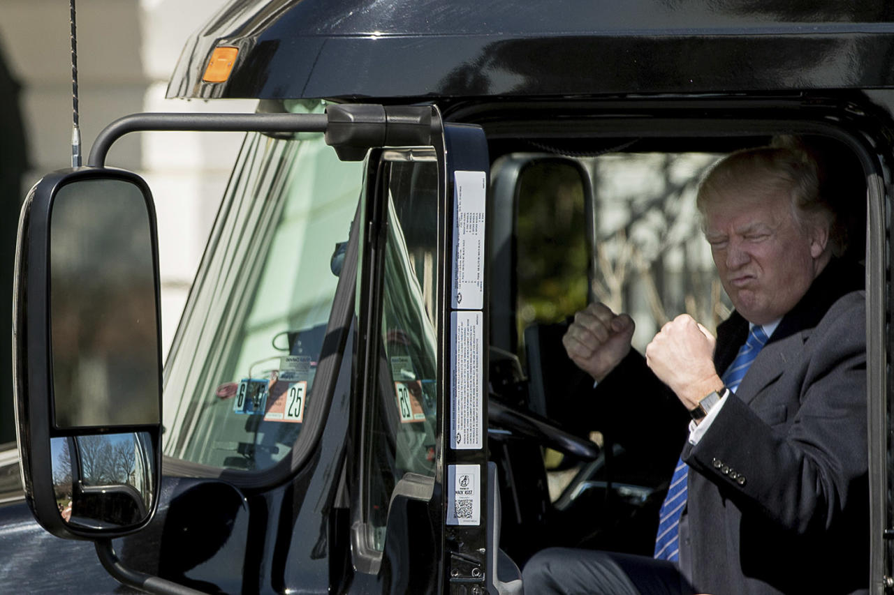 <p>President Trump gestures while sitting in an 18-wheeler truck while meeting with truckers and CEOs regarding health care on the South Lawn of the White House in Washington, March 23, 2017. (Photo: Andrew Harnik/AP) </p>