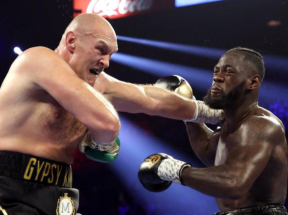 Deontay Wilder (right) and Tyson Fury exchange punches in their rematch (Getty Images)