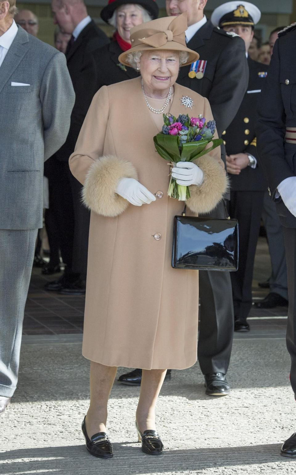 <p>The Queen was bang-on-trend in a fur-lined camel ensemble.<br><i>[Photo: PA]</i> </p>