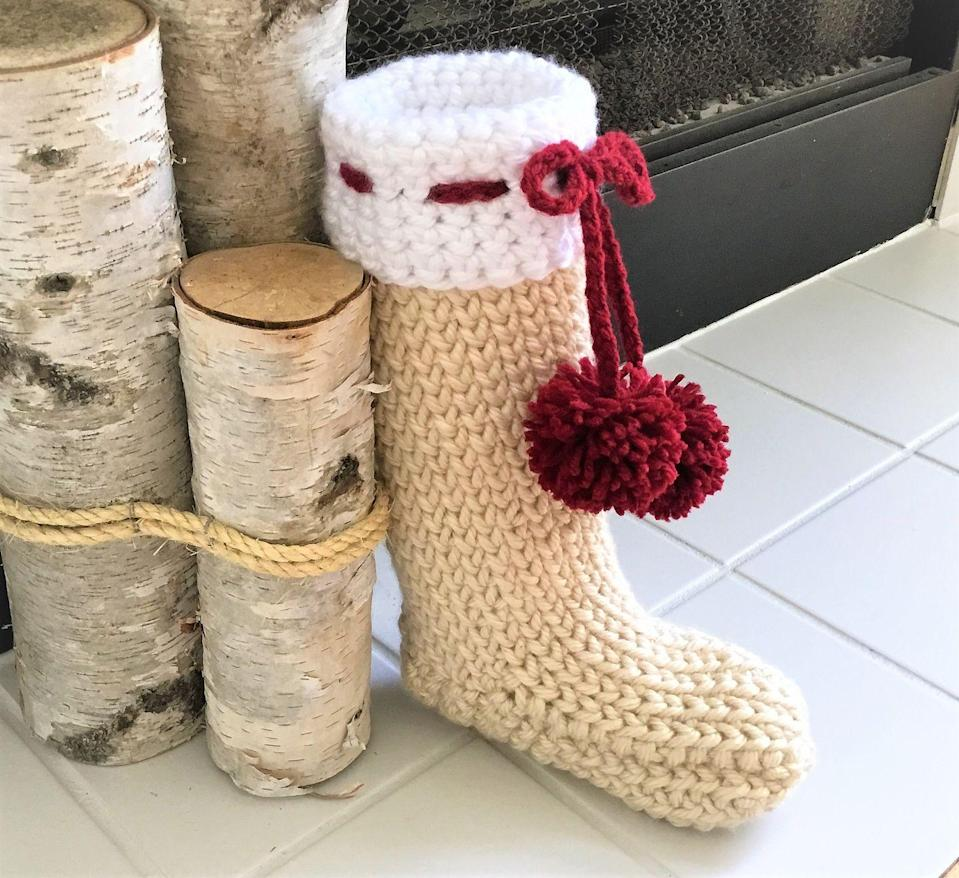 """<p>Picture your home dressed up for the holidays. If you see thick throw blankets, tons of candles, and sparkly lights everywhere, this crochet stocking will fit in flawlessly. The pom-pom bow makes it look even more comfy and cozy.<br></p><p><strong>Get the tutorial at <a href=""""https://crazycoolcrochet.com/farmhouse-christmas-stocking/"""" rel=""""nofollow noopener"""" target=""""_blank"""" data-ylk=""""slk:Crazy Cool Crochet"""" class=""""link rapid-noclick-resp"""">Crazy Cool Crochet</a>.</strong></p><p><a class=""""link rapid-noclick-resp"""" href=""""https://www.amazon.com/Lion-Brand-Yarn-135-099L-Hometown/dp/B0042TLR2U/ref=as_li_ss_tl?tag=syn-yahoo-20&ascsubtag=%5Bartid%7C10050.g.28872655%5Bsrc%7Cyahoo-us"""" rel=""""nofollow noopener"""" target=""""_blank"""" data-ylk=""""slk:SHOP TAN YARN"""">SHOP TAN YARN</a></p>"""