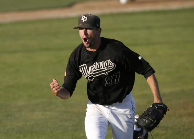 Cal Poly pitcher Casey Bloomquist celebrates after getting the third out of the third inning of an NCAA college baseball tournament regional game against Pepperdine on Saturday, May 31, 2014, in San Luis Obispo, Calif. (AP Photo/Aaron Lambert)