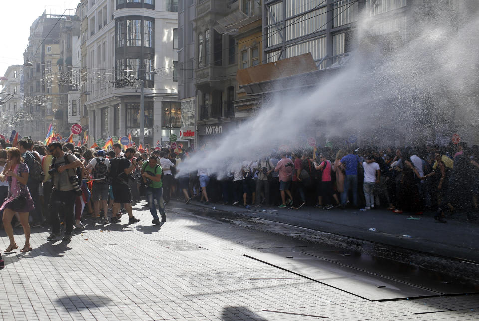 FILE - In this Sunday, June 28, 2015 file photo, Turkish police use a water cannon to disperse participants of a Pride Week march in Istanbul. For several years, Pride Week in Istanbul attracted tens of thousands of participants, making it one of largest gatherings celebrating gay, lesbian and transgender rights and diversity in the Muslim world. That changed suddenly in 2015, when authorities, citing security concerns, banned gay and trans-gender pride events chasing away shocked participants trying to converge on central Taksim Square with tear gas and water cannons. (AP Photo/Emrah Gurel, File)