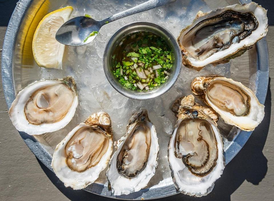 "<p><strong>Give us an overview of the space.</strong> A seafood icon for over 70 years on the Tomales Bay, Tony's had already had an impressive run when the <a href=""https://www.cntraveler.com/restaurants/marshall/hog-island-oyster-co?mbid=synd_yahoo_rss"" rel=""nofollow noopener"" target=""_blank"" data-ylk=""slk:Hog Island Oyster Company"" class=""link rapid-noclick-resp"">Hog Island Oyster Company</a>, bought it in 2017. Now, all spruced up after an extensive renovation, and with a region-honoring menu from Chef Matt Shapiro, Tony's is a storybook fish house. Picture a white-painted single-story building directly on the shore, with simple picnic tables lined up on the patio deck overlooking the bay and large wall-to-wall windows, refurbished wood paneling, and simple, yet modern interior inside. </p> <p><strong>What's the crowd like?</strong> Families in minivans to couples in cabriolets, and everyone in between. Tony's is lively, but not loud. Some folks are taking a proud selfie with a bag full of oysters. Almost everyone is in their leisurely road trip attire.</p> <p><strong>What should we be drinking?</strong> There are local beers and wines, you are not here for the drinks. That said, the Bloody Mary, a tangy, spicy mix with just enough heat, pairs wonderfully with the crispy fish and chips, and is becoming a star on its own.</p> <p><strong>Main event: the food. Give us the lowdown—especially what not to miss.</strong> The famous OG Tony's BBQ oysters are almost mandatory. You will want to sponge up every single drop of the smokey sauce with the house-made bread. If you don't want to eat the clam chowder alone, share it, but please try it. Unlike other flour-heavy chowders, the famous Hog Island Oyster Company clam chowder is a flour-less, lighter, and more refined version of the quintessential coastal dish. Oysters are also sold to-go, and the delicious, salty-sweet Chipotle Bourbon Butter, and Hog Wash, their signature oyster mignonette, will make every oyster picnic on the Bay a special one.</p> <p><strong>And how did the front-of-house folks treat you?</strong> Things can get busy at Tony's hostess desk. Everyone wants to snag a table as soon as possible. But whether you have a reservation or not, the hostess remains calm and shows excellent Tetris skills. The service staff is attentive and doesn't give you a side-eye if your kid (or you) drops a spoon for the 10th time.</p>"