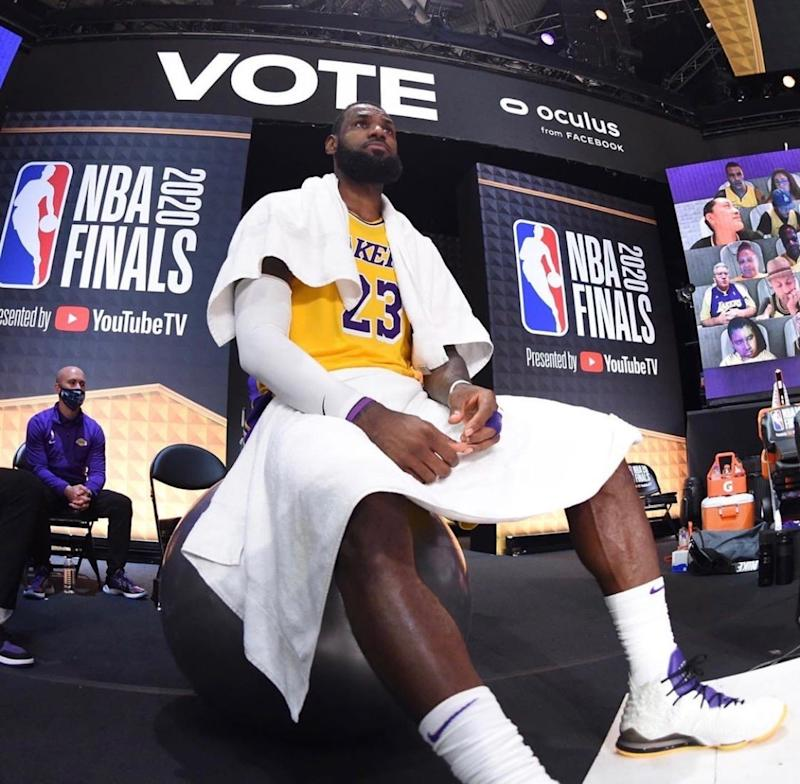 Former Michigan State basketball team manager Andrew Henk had one of the best seats in the NBA's bubble. Here, the equipment manager sits courtside during the NBA finals just behind LeBron James' shoulder.