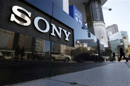 A logo of Sony Corp is seen outside its showroom in Tokyo February 5, 2014. Japanese electronics maker Sony Corp warned it expects a net loss of 110 billion yen ($1.1 billion) this fiscal year as it absorbs restructuring costs linked to its moves to exit the personal computer business. Picture taken February 5, 2014. REUTERS/Yuya Shino