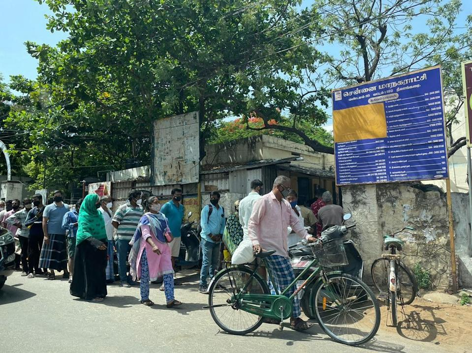 Chennai's locals form a queue for ration.