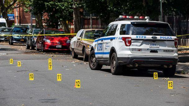 PHOTO: Evidence markers in the street outside of Raymond Bush Playground in Brooklyn, on Monday, July 13, 2020. (Demetrius Freeman/DEMETRIUS FREEMAN/The New York Times/Redux)
