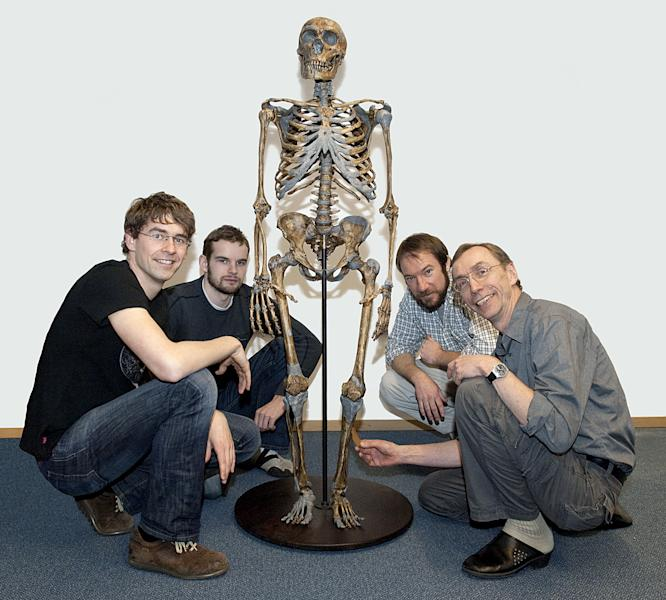 In this undated image, (L-R) Svante Paabo, who headed the recent study, Ed Green, Adrian Briggs and Johannes Krause, pose with a Neanderthal skeleton in Leipzig (AFP Photo/)