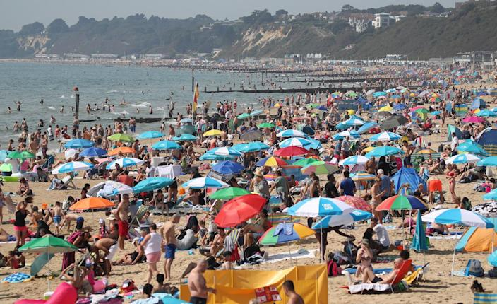 People enjoy the warm weather on Bournemouth beach in Dorset (Picture: PA)