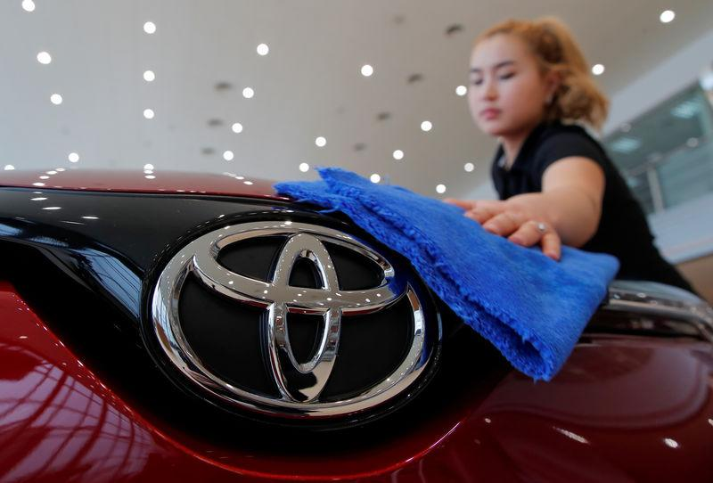 An employee cleans a Toyota car at Rolf, an automotive dealer, in Moscow