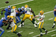 Green Bay Packers quarterback Aaron Rodgers (12) throws during the first half of an NFL football game against the Detroit Lions, Sunday, Dec. 13, 2020, in Detroit. (AP Photo/Carlos Osorio)