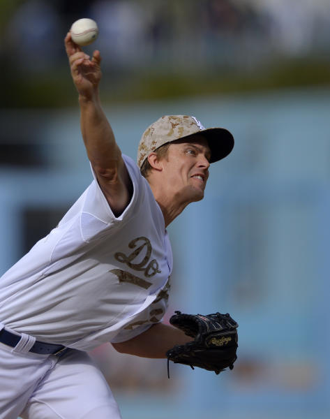 Los Angeles Dodgers starting pitcher Zack Greinke throws to the plate during the first inning of their baseball game against the Los Angeles Angels, Monday, May 27, 2013, in Los Angeles. (AP Photo/Mark J. Terrill)