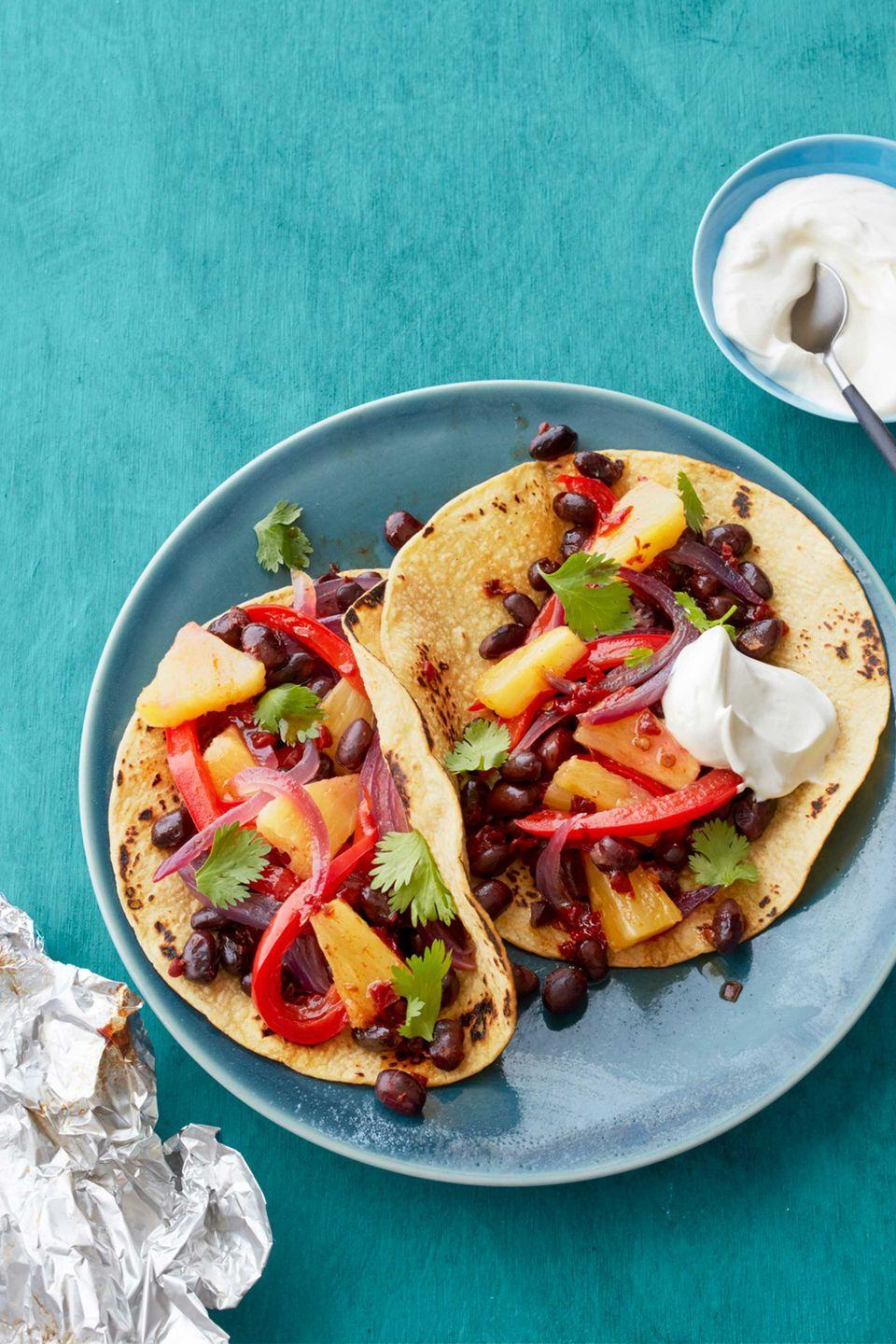 "<p>Mexican goes meatless with these sweet and smoky vegetarian fajitas.</p><p><a href=""https://www.womansday.com/food-recipes/food-drinks/recipes/a55764/pineapple-and-black-bean-fajitas-recipe/"" rel=""nofollow noopener"" target=""_blank"" data-ylk=""slk:Get the Pineapple and Black Bean Fajitas recipe."" class=""link rapid-noclick-resp""><em><strong>Get the Pineapple and Black Bean Fajitas recipe.</strong></em></a></p>"