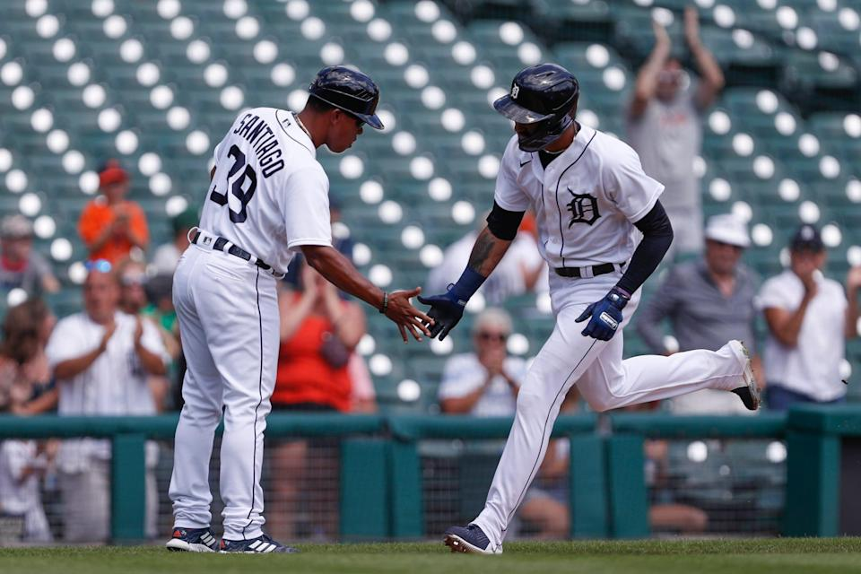 Tigers center fielder Derek Hill, right, celebrates with third base coach Ramon Santiago after hitting a solo home run during the third inning against the Twins on Monday, Aug. 30, 2021, at Comerica Park.