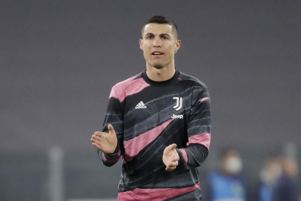 Juventus' Cristiano Ronaldo applauds during warmup before the Champions League, round of 16, second leg, soccer match between Juventus and Porto in Turin, Italy, Tuesday, March 9, 2021. (AP Photo/Luca Bruno)