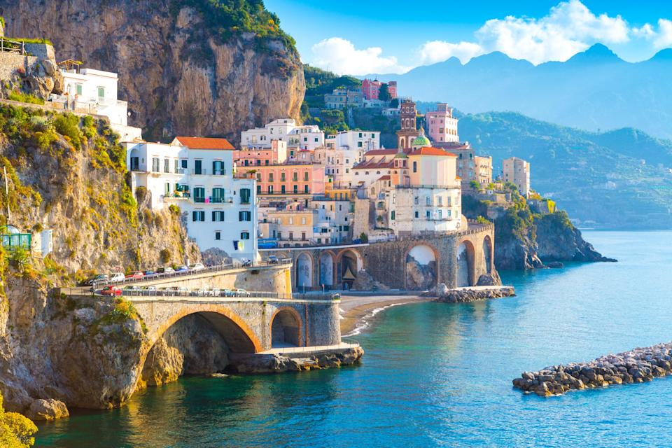 """September is one of the best months to visit the Amalfi Coast, with comfortable temperatures (highs in the 70s and 80s) and far fewer crowds than during the summer. And since Italy officially reopened to vaccinated American tourists for quarantine-free travel in June, you can enjoy the beautiful region without having to wait for COVID test results in your hotel room. Spend time exploring the famously colorful towns along the coastline, like the show-stopping views at Positano and the romantic gardens at Ravello. Book a stay at the blissfully secluded, 20-room <a href=""""https://www.cntraveler.com/hotels/italy/conca-dei-marini/monastero-santa-rosa-hotel-spa-amalfi-coast?mbid=synd_yahoo_rss"""" rel=""""nofollow noopener"""" target=""""_blank"""" data-ylk=""""slk:Monastero Santa Rosa Hotel & Spa"""" class=""""link rapid-noclick-resp"""">Monastero Santa Rosa Hotel & Spa</a>, which occupies a restored 17th-century monastery just three miles from Amalfi. After spending an afternoon swimming in the clifftop pool and getting treatments at the spa, enjoy local Campanian specialties at Il Refettorio, the Michelin-starred restaurant."""