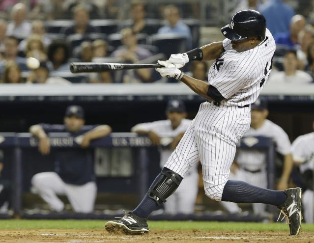 FILE - In this Aug. 21, 2013 file photo, New York Yankees' Curtis Granderson hits an RBI single during the third inning of a baseball game against the Toronto Blue Jays, in New York. A person familiar with the situation says free-agent outfielder Granderson and the New York Mets have agreed to a $60 million, four-year contract. The person spoke to The Associated Press on condition of anonymity Friday, Dec. 6, 2013, because the deal was pending a physical and no announcement had been made. (AP Photo/Frank Franklin II, File)