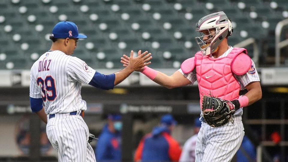 New York Mets pitcher Edwin Diaz celebrates with catcher James McCann (33) after recording a save in a 4-2 victory over the Arizona Diamondbacks at Citi Field.