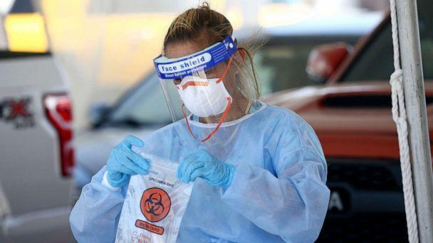 PHOTO: A specimen is secured at a drive-thru coronavirus testing site at South Mountain Community College, July 9, 2020, in Phoenix. (Ross D. Franklin/AP)