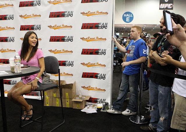 HOUSTON, TX - OCTOBER 08: UFC Octagon Girl Arianny Celeste poses for photos with fans at the UFC Fan Expo inside the George R. Brown Convention Center on October 8, 2011 in Houston, Texas.