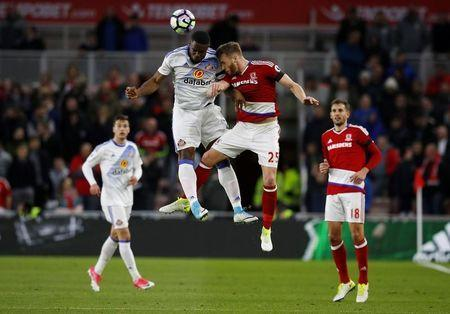 Britain Soccer Football - Middlesbrough v Sunderland - Premier League - The Riverside Stadium - 26/4/17 Sunderland's Victor Anichebe and Middlesbrough's Calum Chambers challenge for the ball in the air Reuters / Phil Noble Livepic