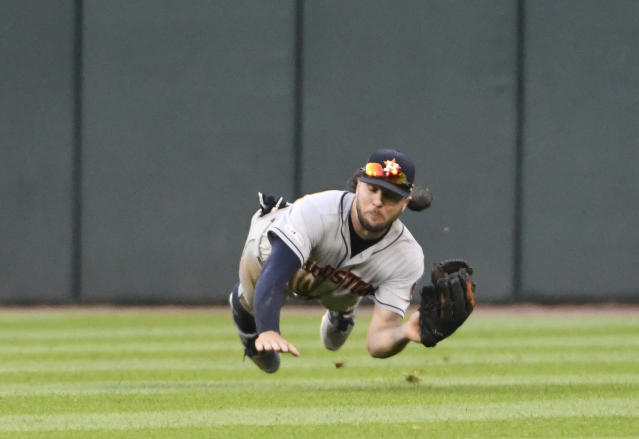Houston Astros center fielder Jake Marisnick makes the catch on ball hit by Chicago White Sox's Eloy Jimenez during the ninth inning of the first game of a baseball doubleheader Tuesday, Aug. 13, 2019, in Chicago. (AP Photo/David Banks)