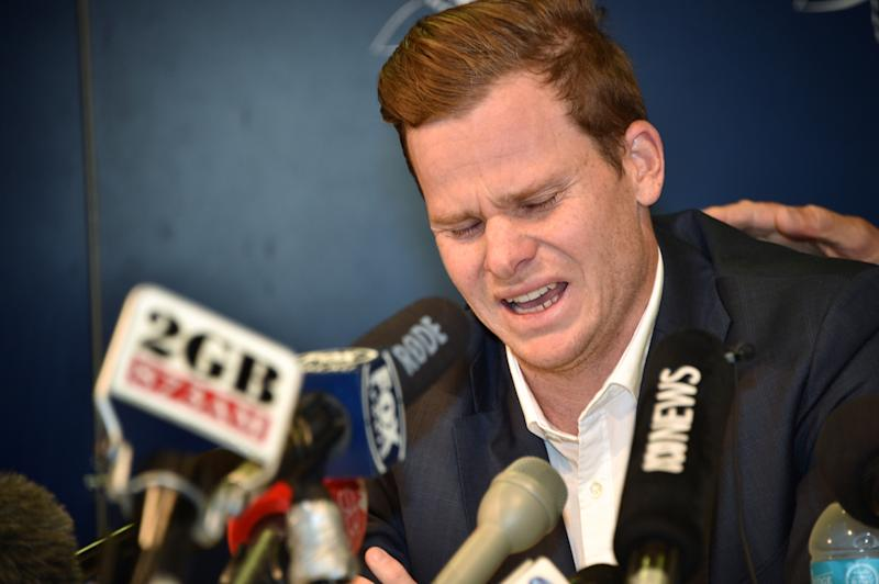 "TOPSHOT - Cricketer Steve Smith reacts at a press conference at the airport in Sydney on March 29, 2018, after returning from South Africa. Distraught Australian cricketer Steve Smith on March 29 accepted full responsibility for a ball-tampering scandal that has shaken the sport, saying he was devastated by his ""big mistake"". / AFP PHOTO / Peter PARKS / -- IMAGE RESTRICTED TO EDITORIAL USE - STRICTLY NO COMMERCIAL USE -- (Photo credit should read PETER PARKS/AFP/Getty Images)"