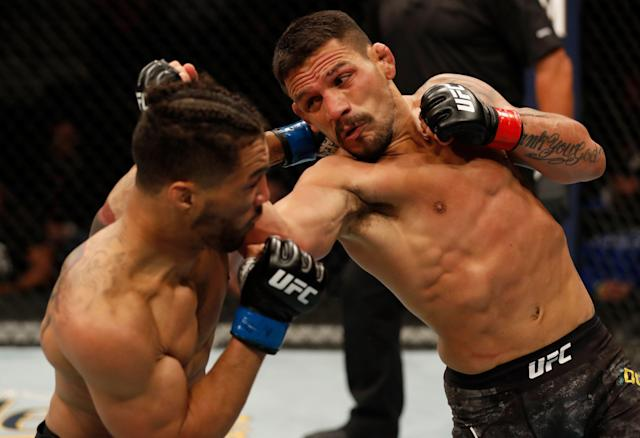 Rafael Dos Anjos (R) of Brazil punches Kevin Lee in their welterweight UFC main event Saturday, May 18 in Rochester, New York. (Getty Images)