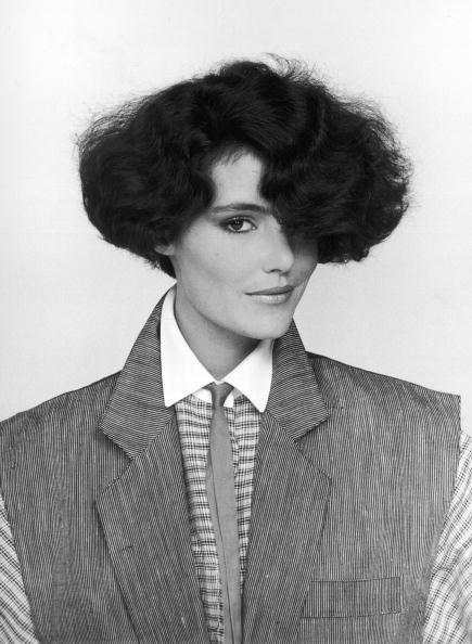 <p>The '80s were known for volume. At all lengths, women wanted their hair to be full, full, and more full. Here, a model wears her hair in a style that's short on the bottom but voluminous on top. </p>