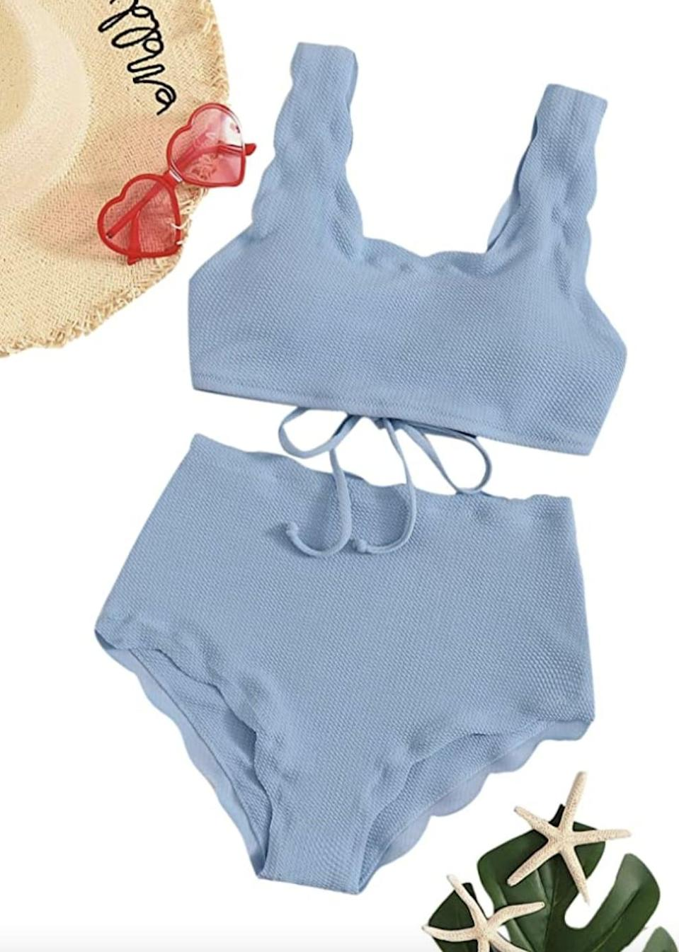 <p>This <span>SweatyRocks High-Waist Scalloped Bikini</span> ($23) has a charming silhouette and playful color palette you'll be sure to love.</p>