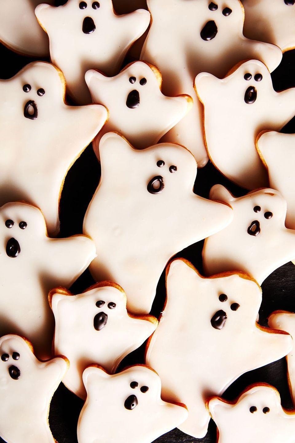"""<p>If you put out a tray of these simple and tasty cookies prepare to have each ghost spookily disappear. </p><p><strong><em>Get the recipe at <a href=""""https://www.delish.com/holiday-recipes/halloween/a28637917/ghost-cookies-recipe/"""" rel=""""nofollow noopener"""" target=""""_blank"""" data-ylk=""""slk:Delish"""" class=""""link rapid-noclick-resp"""">Delish</a>. </em></strong></p>"""