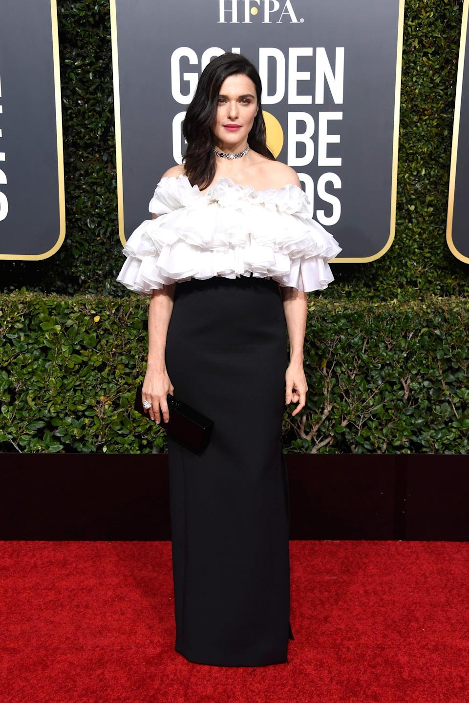 <p>Wearing a Celine by Hedi Slimane dress with Cartier jewels.</p>