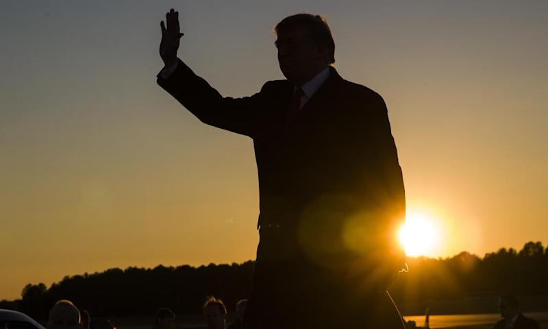 Donald Trump waves as he arrives to speak in Tupelo, Mississippi, in November.