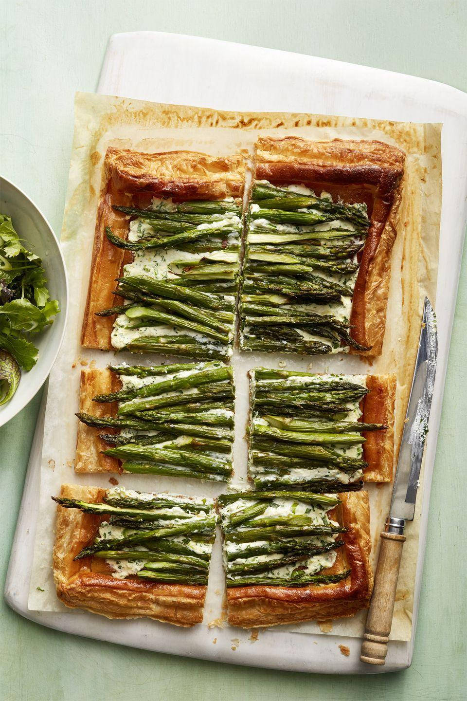 """<p>Layers of puff pastry and ricotta cheese make this veggie tart an easy, yummy vegetarian meal guaranteed to satisfy all.</p><p><a href=""""https://www.womansday.com/food-recipes/food-drinks/recipes/a58519/asparagus-ricotta-tart-recipe/"""" rel=""""nofollow noopener"""" target=""""_blank"""" data-ylk=""""slk:Get the Asparagus and Ricotta Tart recipe."""" class=""""link rapid-noclick-resp""""><em>Get the Asparagus and Ricotta Tart recipe.</em></a></p>"""