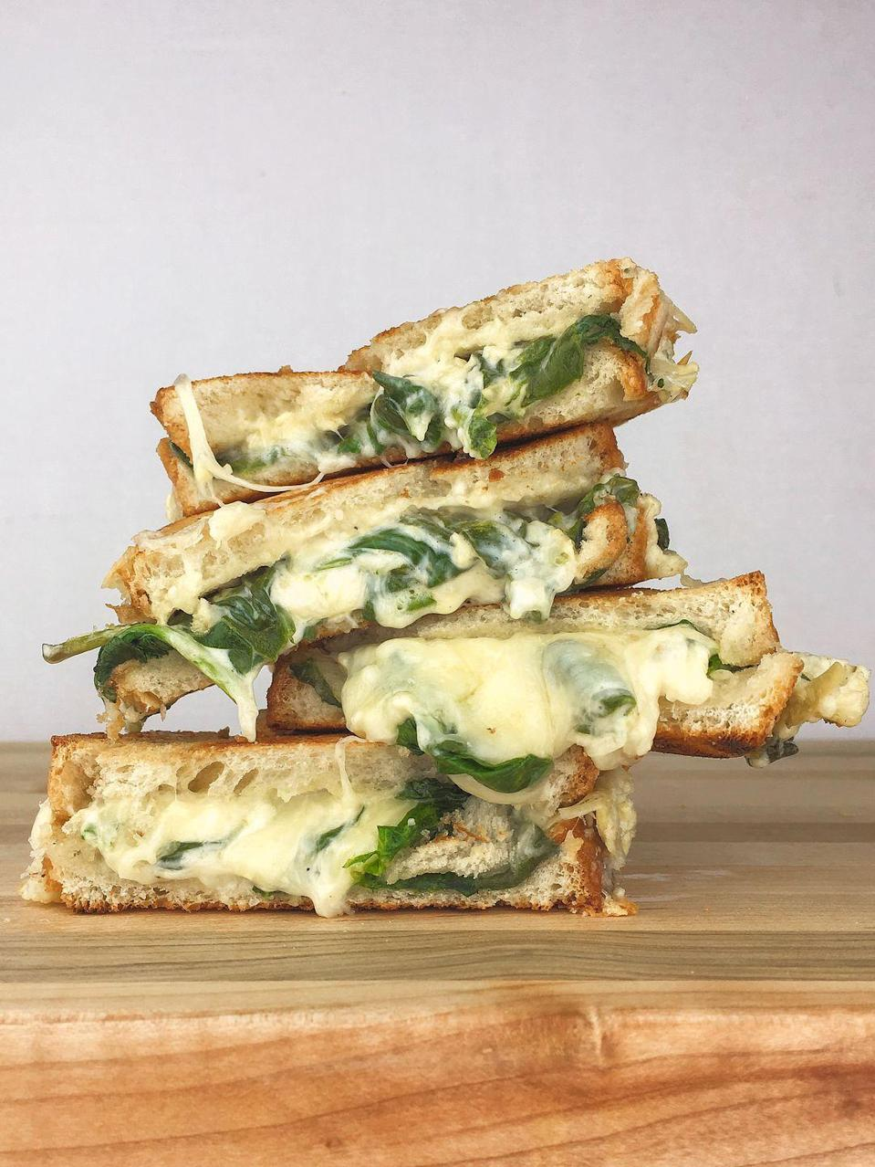 """<p>Grilled cheese goes green.</p><p>Get the recipe from <a href=""""/cooking/recipe-ideas/recipes/a46500/spinach-artichoke-grilled-cheese-recipe/"""" data-ylk=""""slk:Delish"""" class=""""link rapid-noclick-resp"""">Delish</a>.</p>"""