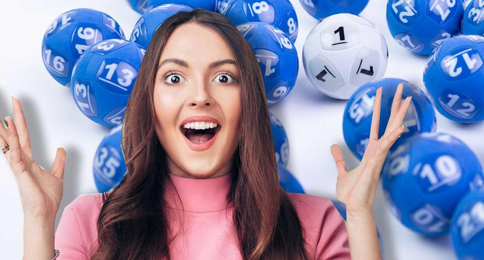 A woman is pictured with the Powerball balls.