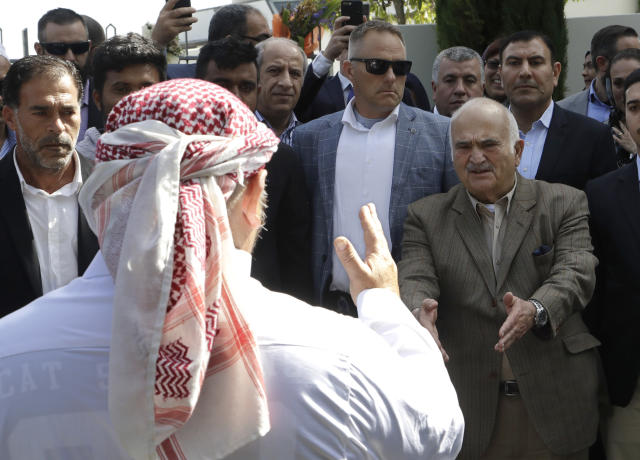 His Royal Highness Prince El Hassan bin Talal Hashemite, second right, of Jordan, greets a worshipper who had just performed a haka outside the Al Noor mosque in Christchurch, New Zealand, Saturday, March 23, 2019. The mosque reopened today following the March 15 mass shooting. (AP Photo/Mark Baker)