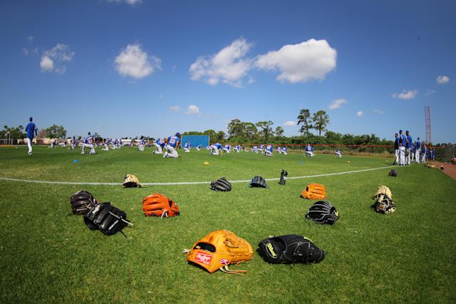 <p>The equipment of New York Mets minor leaguers sits on the field during workouts at the Mets' minor league complex in Port St. Lucie, Fla. on March 2, 2018. (Photo: Gordon Donovan/Yahoo News) </p>