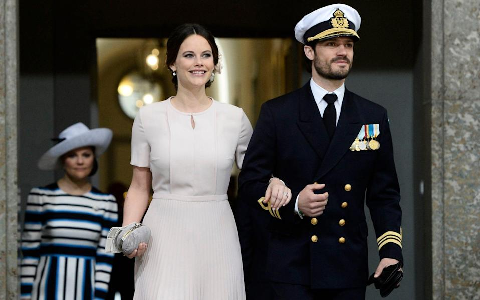 Princess Sofia and Prince Carl Philip arrive for the Te Deum thanksgiving service in the Royal Chapel  - AFP