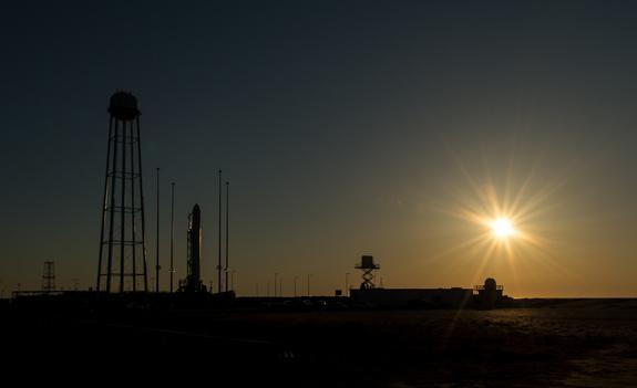 Orbital Sciences Corp.'s first Antares rocket is seen during sunrise on the Mid-Atlantic Regional Spaceport (MARS) Pad-0A at the NASA Wallops Flight Facility in Virginia, Sunday, April 21, 2013. Liftoff is set for 5 p.m. ET.