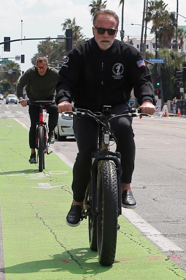 <p>Arnold Schwarzenegger goes for a bicycle ride in Los Angeles on Saturday.</p>