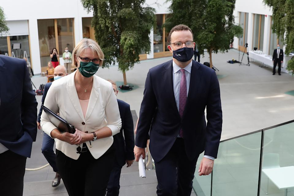 German health minister Jens Spahn, right, with education minister Anja Karliczek, on their way to attend a press conference in Berlin, Germany. Photo: Hayoung Jeon/Getty Images