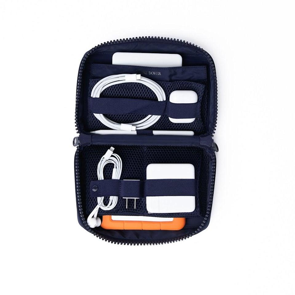 """<h2>Dagne Dover Arlo Tech Organizer</h2><br>You've probably heard of, witnessed, or partook in the recent travel rebirth, and this Dagne Dover tech organizer is perfect for plane trips — especially for dads who bring every tech product they own in their carry-on. <br><br><em>Shop</em> <strong><em><a href=""""http://dagnedover.com"""" rel=""""nofollow noopener"""" target=""""_blank"""" data-ylk=""""slk:Dagne Dover"""" class=""""link rapid-noclick-resp"""">Dagne Dover</a></em></strong><br><br><strong>Arlo</strong> Arlo Tech Organizer, $, available at <a href=""""https://go.skimresources.com/?id=30283X879131&url=https%3A%2F%2Fwww.dagnedover.com%2Fcollections%2Farlo-tech-organizer"""" rel=""""nofollow noopener"""" target=""""_blank"""" data-ylk=""""slk:Dagne Dover"""" class=""""link rapid-noclick-resp"""">Dagne Dover</a>"""