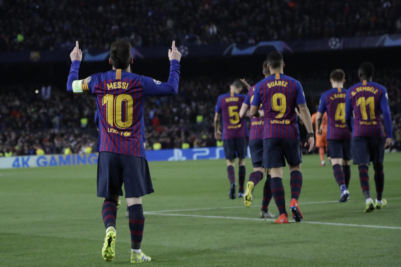 Barcelona's Lionel Messi left celebrates after scoring his side's third goal during the Champions League round of 16 2nd leg soccer match between FC Barcelona and Olympique Lyon at the Camp Nou stadium in Barcelona Spain Wednesday March 1
