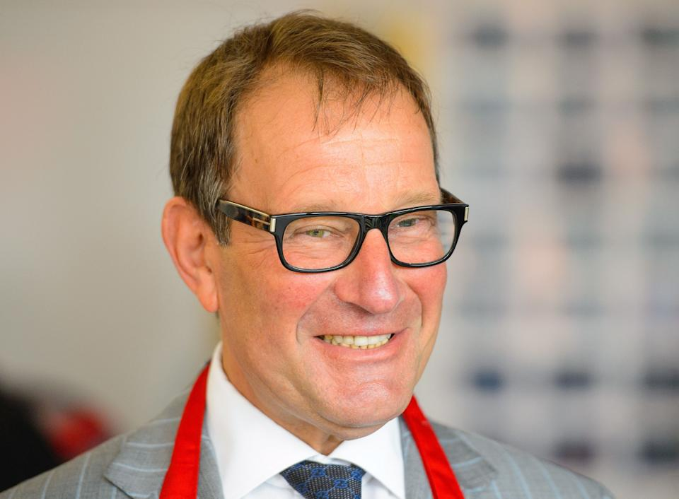 Health Lottery owner Richard Desmond takes part in a 'Lets Get Cooking' session, at Twickenham Academy, in Twickenham, London, which aims bring young people together and give them the practical skills, knowledge and confidence to cook and enjoy food.