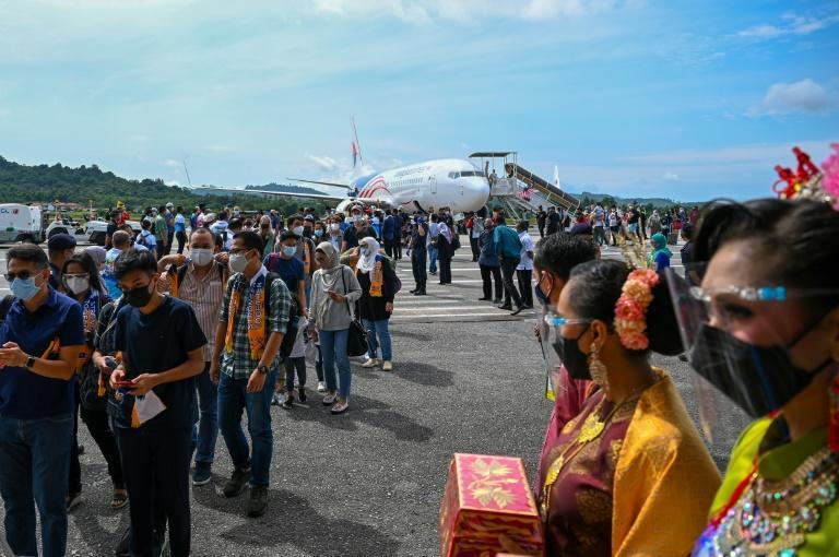 Domestic tourists disembark from a Malaysia Airlines plane after landing in Langkawi (AFP/Mohd RASFAN)